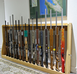 Quality rotary gun racks quality pistol racks gun rack for Walk in gun safe plans